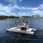 Kids on the pontoon paddle boat